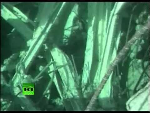 Close-up underwater footage of Fukushima reactor spent fuel pool in debris